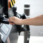 """paying for gas, small DOF.  Other images from this series:"""